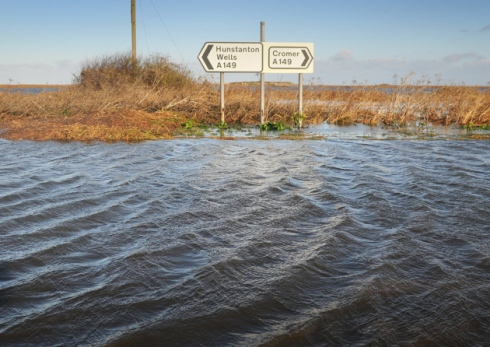 The A149 through Salthouse totally covered with sea water.